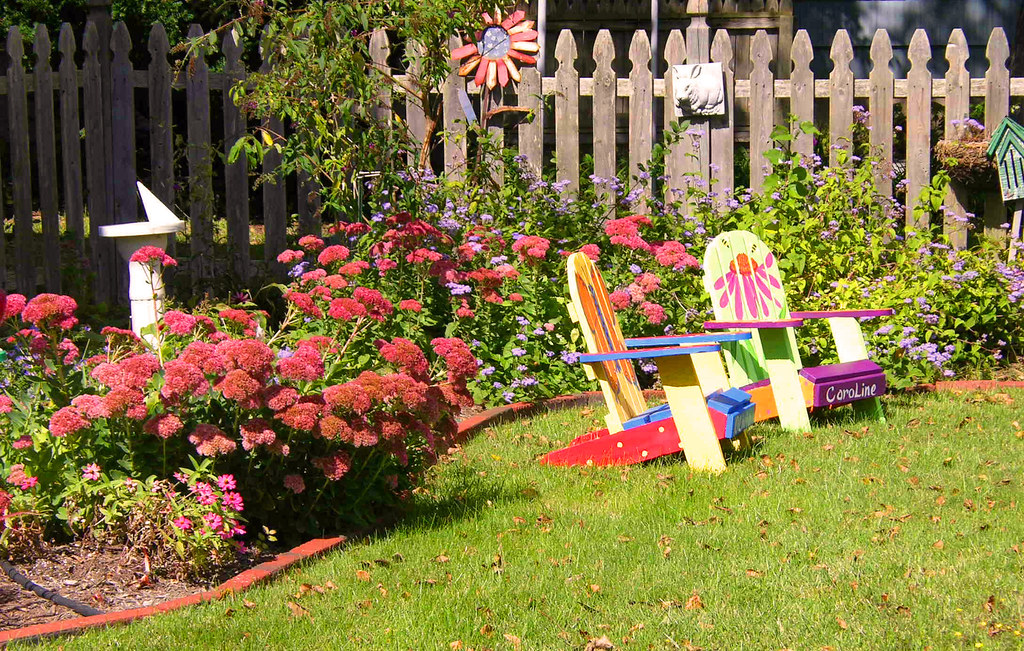 CHILDS GARDEN CHAIRS | Hand painted childrens chairs amidst ...