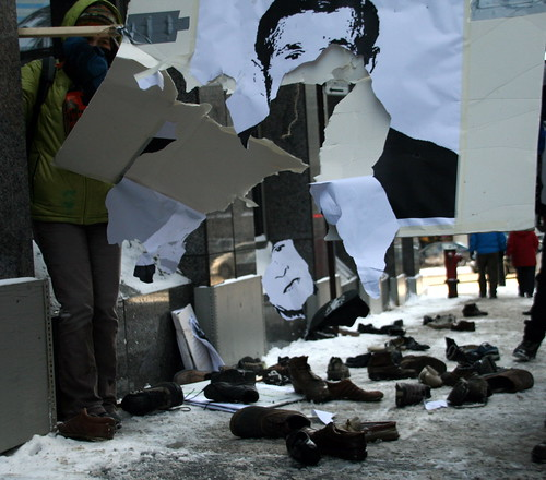 Protesters Throwing Shoes at Bush posters in Montreal | by Anirudh Koul