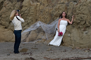 1 of 4 Female wedding photographer on Morro Strand State Beach, Morro Bay, CA | by mikebaird