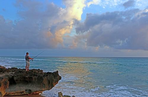 ocean sun fish water sunrise fishing fisherman rocks florida stuart atlantic atlanticocean houseofrefuge hutchinsonisland