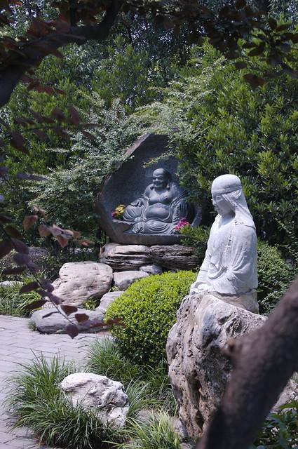 Happy Buddha in a garden - Beijing, China, 2008.