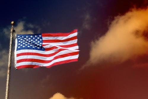 Flag in a fiery sky