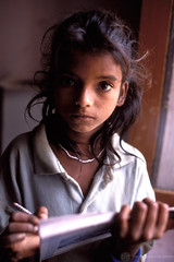 Young girl, taken out of child labour, being given a non-formal education at school. India | by World Bank Photo Collection