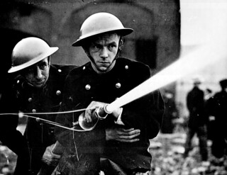 500 firemen and members of the London Auxiliary Fire Fighting Services   by Marion Doss