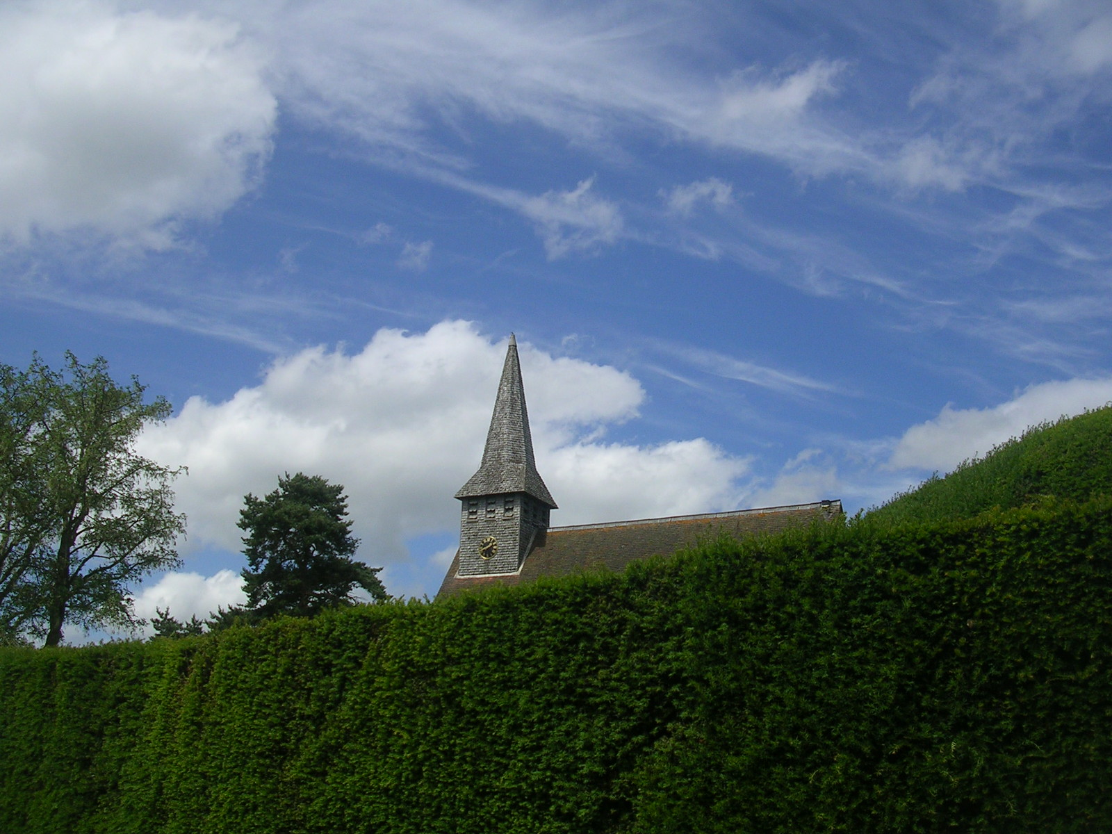 Klu Klux Church A sinister hoodie peers over the hedge. Hascombe. Milford to Godalming