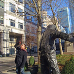 Canary Wharf: Man with Arms Open by Giles Penny, West India Avenue