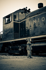 Dallin by a Train Engine | by Aaron Barker