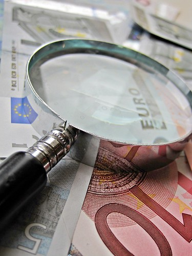 Euros and Magnifying Glass | by Images_of_Money