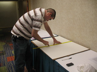 Richard cutting up the foam boards for the signage