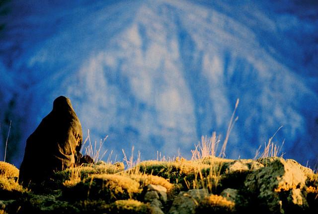 Woman by mountain