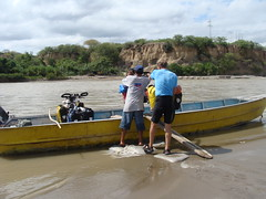 Loading the bikes into the boat for the crossing of the Rio Marañon