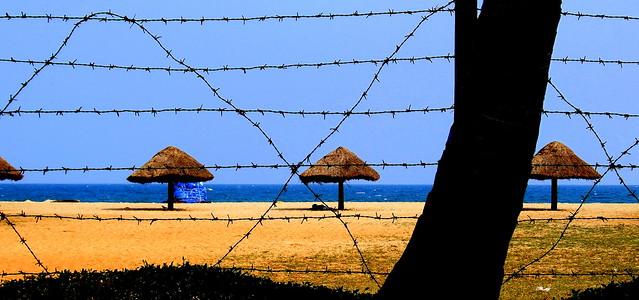 The private beach at the Pondicherry Ashok