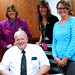 Seated, John Chidester.  Standing L-R Beverly Cain, Kristi White, Jessica Horlacher.  Kristi recently received Library Support Staff Certification from the Ohio Library Council.  On Monday, July 13, 2015, State Librarian Beverly Cain and Bill Morris visited the Public Library of Mount Vernon and Knox County.