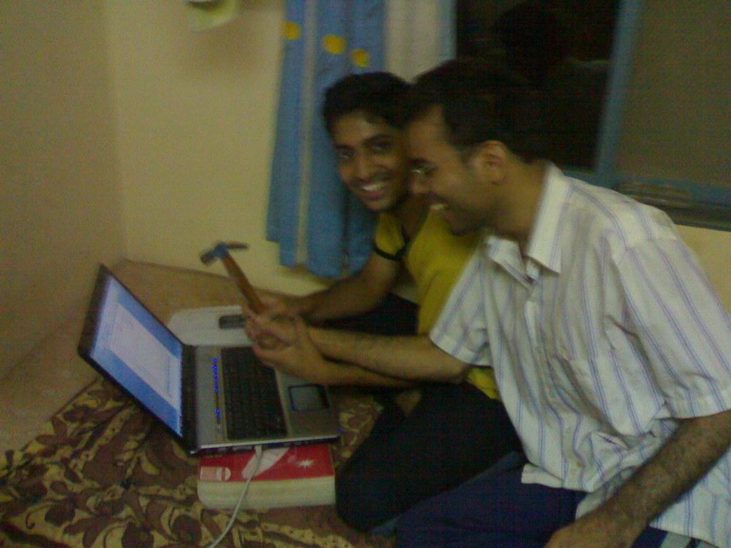 hammering laptop