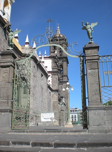 Puebla cathedral - the fence around it is topped with statues of angels
