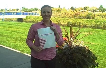 Kendra Morgan with her Cookbook