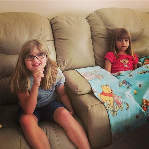 Uncle Chris & Mandy's house has a big couch with a big TV. They've wasted no time making themselves at home. | by poobou