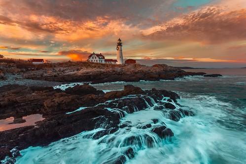 seashore lighthouse rocky seascape sky clouds maine