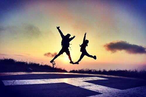 couple sunset love jump