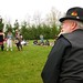Dapper photographer watches The Carnival Band. by Boba.Ferret