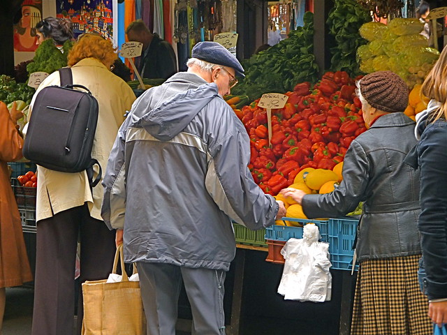 Couple buying Market Fruit