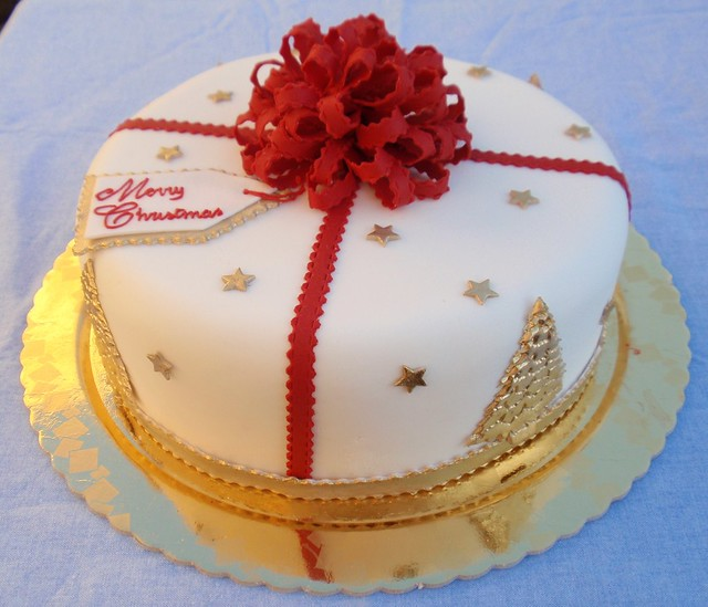 Christmas cake with bow and gold trees