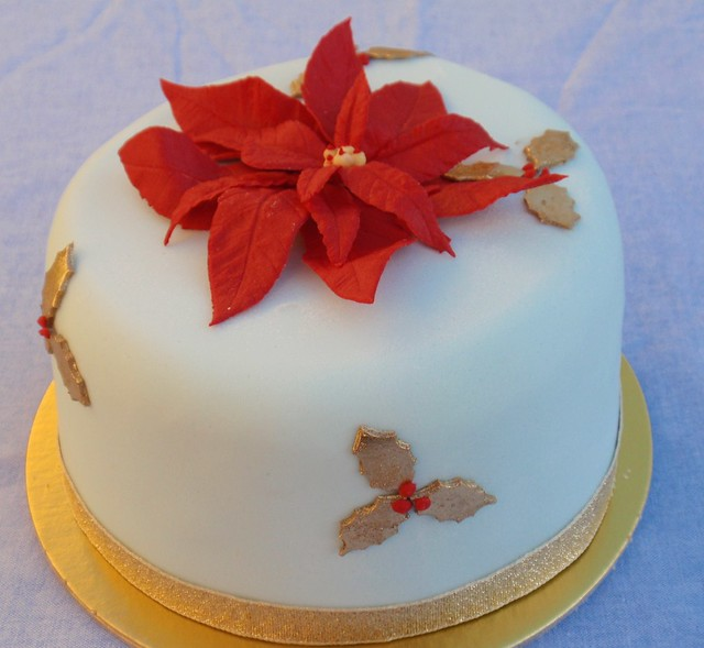 Christma cake with poinsettia and gold holly