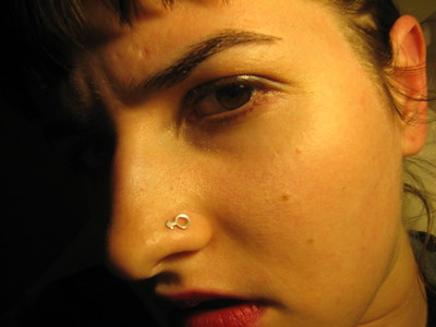 My new nose ring is a man symbol ... I mistook it for a woman one ...