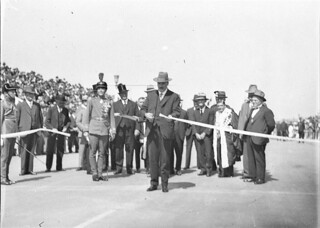 Jack Lang, watched by Sir Philip Game, cuts official ribbon, 19th March 1932 / photographed by Sam Hood