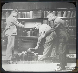 Three men at dusting books | by New York Public Library