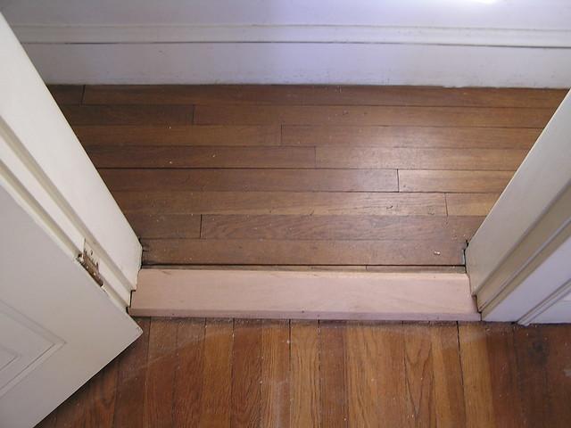 Narrow closet with new threshold