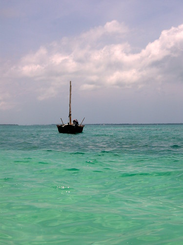 Dhow in the sun at Kendwa beach   by mattk1979