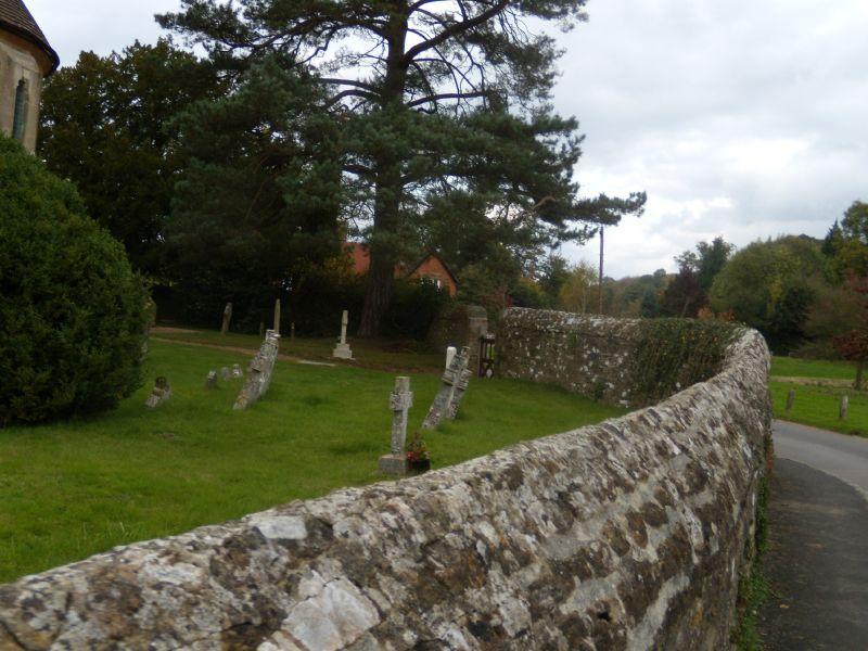 Churchyard wall St Peter's church, Hascombe. Milford to Godalming