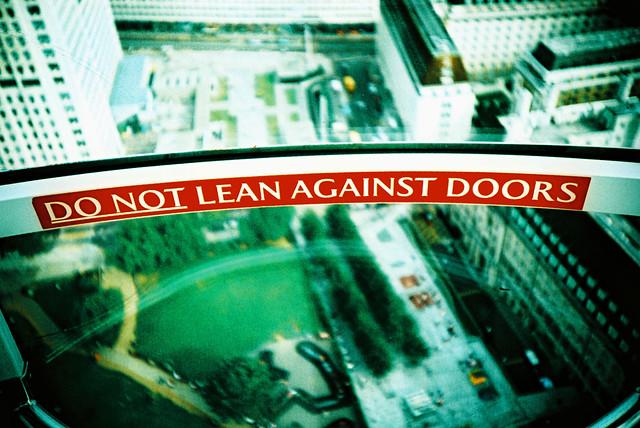 DO NOT lean against doors