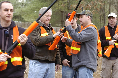 Photo of hunters being shown firearms safety tips