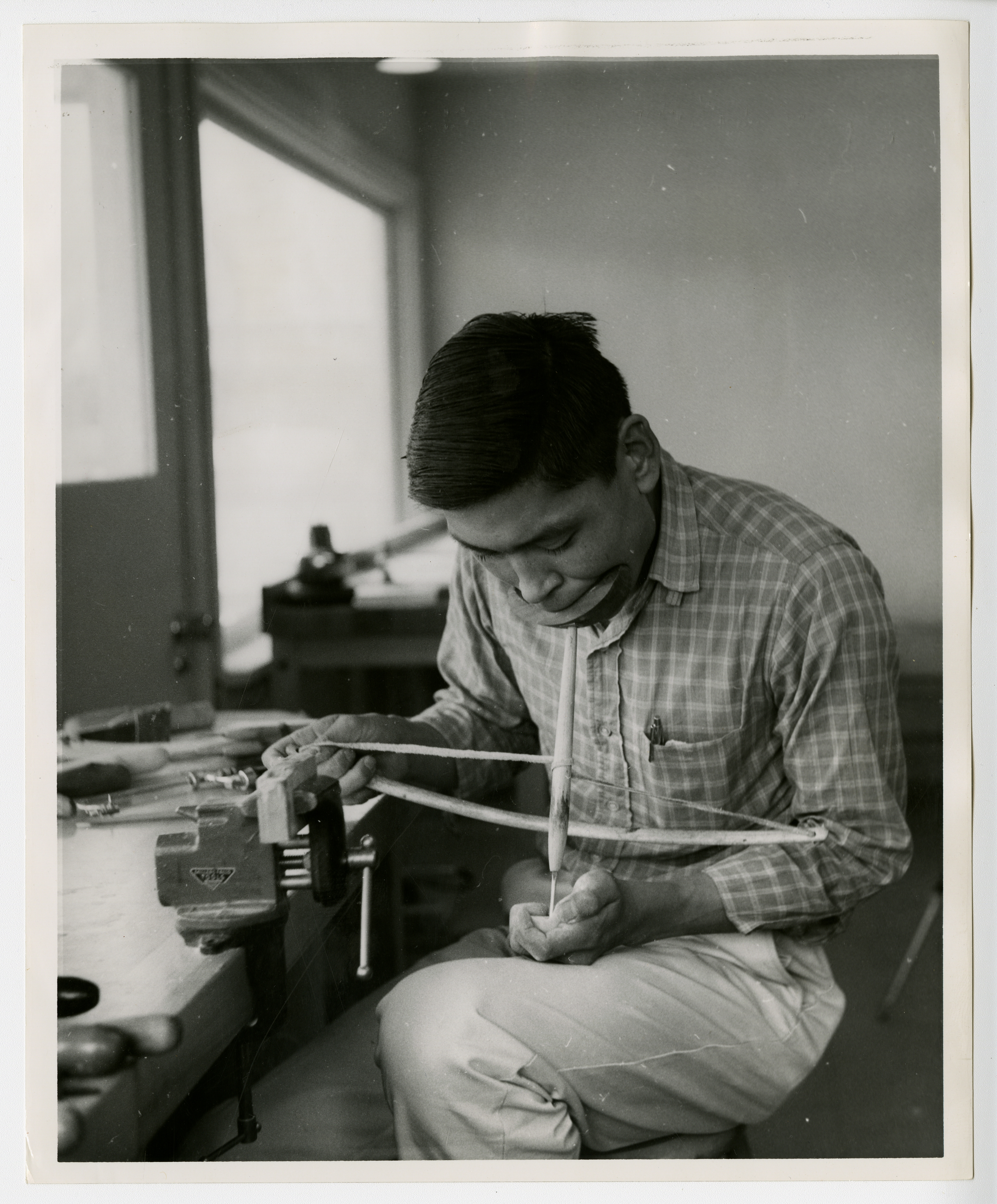 Sitka National Monument 1962-65, page 92 [Original Caption: Peter Seegama working on ivory]