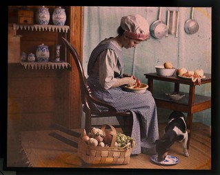 Genre scene, woman in kitchen peeling vegetables | by George Eastman Museum