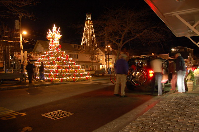 Lobster Pot Christmas pyramid light up at night, as is the Pilgrim Monument