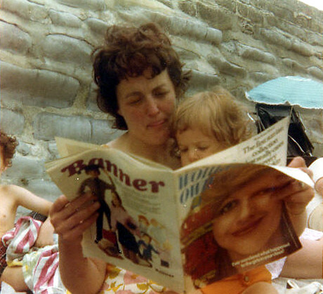 mum and Anne reading Woman's Own on the beach