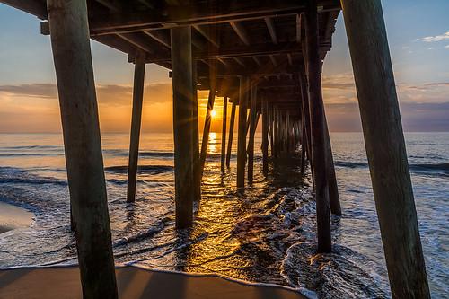ocean beach sunrise pier waves sunrays virginiabeach hamptonroads