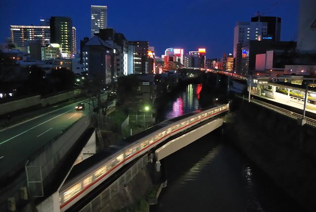 A Tokyo Metro Marunouchi Line Train Going across the Kanda River