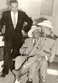 "Cowboy Gene Autry fitting the photographer with ""real"" Cow ..."