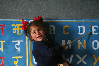 Little girl at Shreeshitalacom Lower Secondary School leads class in pronunciation of alphabet. Kaski, Nepal | by World Bank Photo Collection