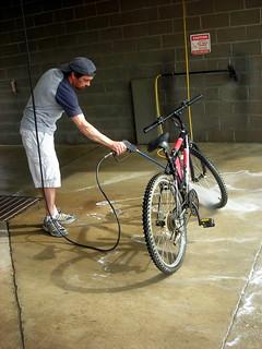 Hosing down dad's bike