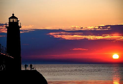 travel sunset sky usa dog sun lighthouse lake reflection men net water silhouette clouds pier spring fishing dock midwest michigan lakemichigan ripples catwalk 0114 bigmomma challengeyouwinner nikond80 thechallengefactory manisteenorthpierhead richgreenephotography