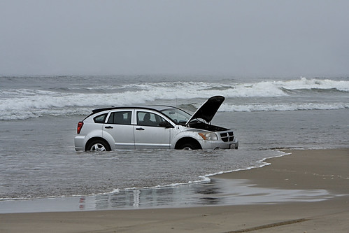 Car stuck in the surf | by Alan Vernon.
