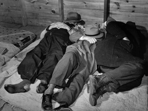 "Marion Post Wolcott: Farmers Sleeping in a ""white"" camp room in a warehouse. They often must remain several days before their tobacco is sold. Durham, North Carolina, 1939"