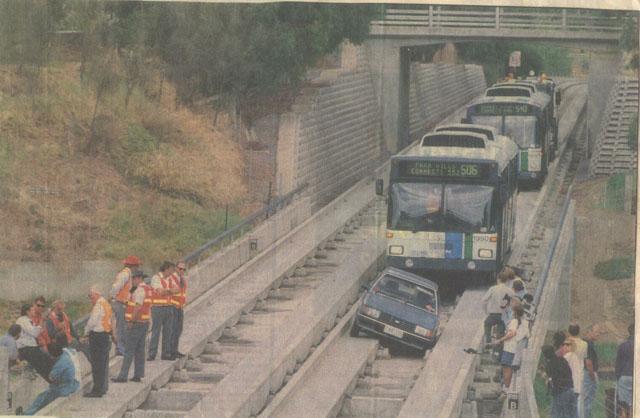 Ford Laser On O- Bahn Track - Newspaper Photo