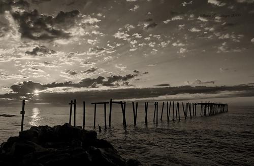 ocean old sky usa sun beach broken water clouds sunrise d50 pier blackwhite newjersey nikon ruins waves nj atlantic shore oceancity sunrays soe ocnj brokenpier aplusphoto
