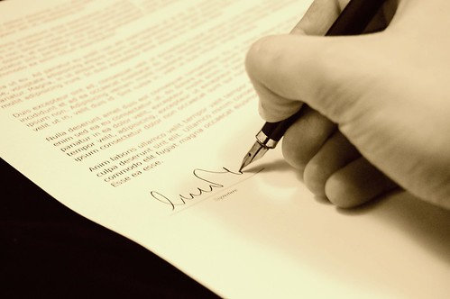 Business Contract- Credit to informedmag.com | by Informedmag